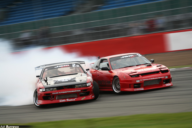 Luke Fink and Jon Calvert nearly touching while drifting